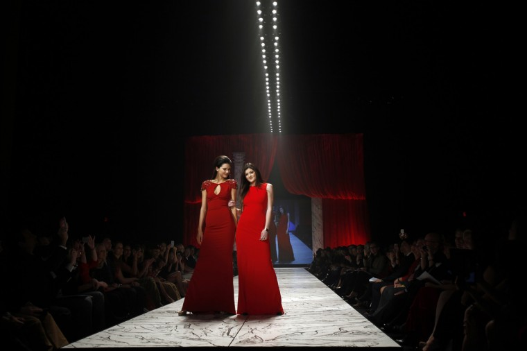 Kendall Jenner (L) and Kris Jenner present creations during the The Heart Truth's Red Dress Collection fashion show in New York. (Carlo Allegri/Reuters)