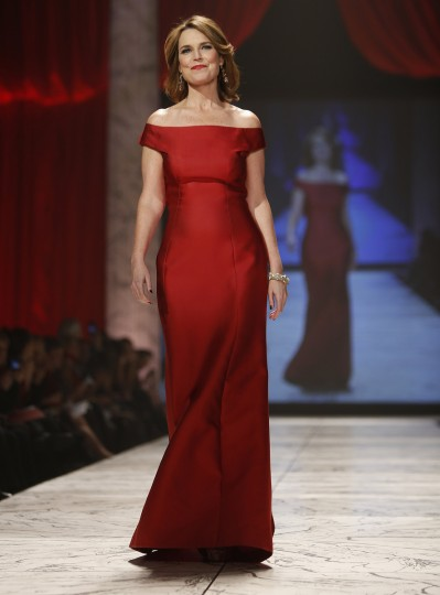 Savannah Guthrie of the Today show presents a creation during The Heart Truth's Red Dress Collection fashion show in New York. (Carlo Allegri/Reuters)