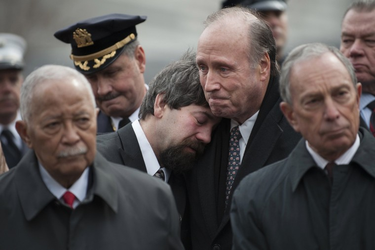 Stephen Knapp (L) is comforted by Charles Maikish, former World Trade Center Director, as mourners and family members of victims participate in a 20th anniversary memorial for victims of the 1993 bombing of the World Trade Center in New York. (Keith Bedford/Reuters)