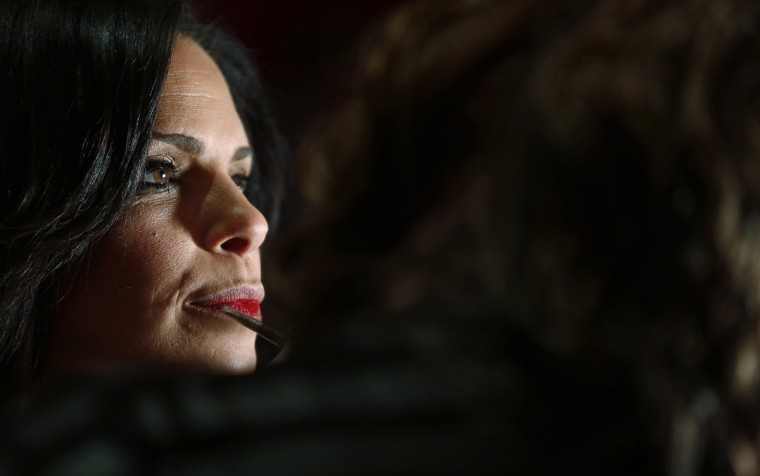 Journalist Soledad O'Brien has makeup applied before the The Heart Truth's Red Dress Collection fashion show in New York. (Carlo Allegri/Reuters)