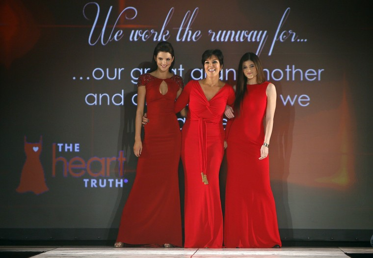 ( L to R) Kendall Jenner, Kris Jenner and Kylie Jenner present creations during the The Heart Truth's Red Dress Collection fashion show in New York. (Carlo Allegri/Reuters)