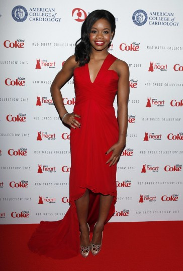"U.S. Olympic gymnast Gabrielle ""Gabby"" Douglas arrives before the The Heart Truth's Red Dress Collection fashion show in New York. (Carlo Allegri/Reuters)"