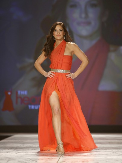 Actress Minka Kelly presents a creation during the The Heart Truth's Red Dress Collection fashion show in New York. (Carlo Allegri/Reuters)