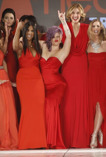 (From L) Kendall Jenner, Toni Braxton, Kelly Osbourne, Brenda Strong and Torah Bright present creations at the end of The Heart Truth's Red Dress Collection fashion show in New York. (Carlo Allegri/Reuters)