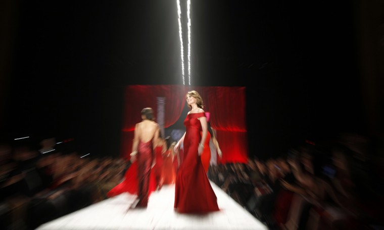 American journalist Savannah Guthrie (C) presents a creation at the end of The Heart Truth's Red Dress Collection fashion show in New York. (Carlo Allegri/Reuters)