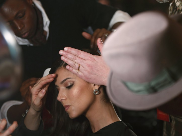 Actress Roselyn Sanchez has makeup applied before the The Heart Truth's Red Dress Collection fashion show in New York. (Carlo Allegri/Reuters)
