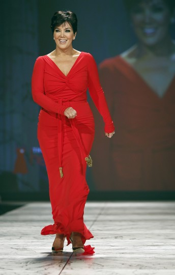 TV personality Kris Jenner presents a creation during the The Heart Truth's Red Dress Collection fashion show in New York. (Carlo Allegri/Reuters)