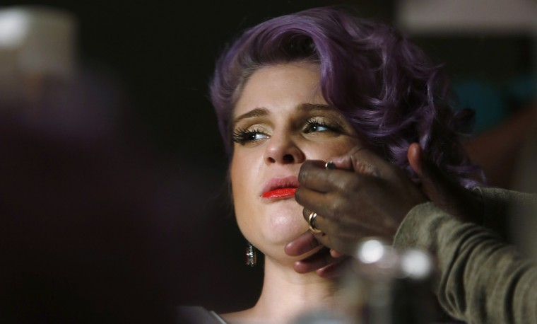 TV personality Kelly Osbourne has makeup applied before The Heart Truth's Red Dress Collection fashion show in New York. (Carlo Allegri/Reuters)