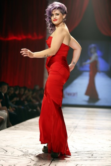 TV personality Kelly Osborne presents a creation during the The Heart Truth's Red Dress Collection fashion show in New York. (Carlo Allegri/Reuters)