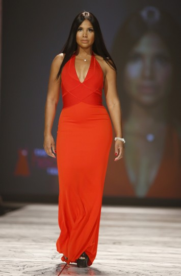 Singer Toni Braxton presents a creation during The Heart Truth's Red Dress Collection fashion show in New York. (Carlo Allegri/Reuters)