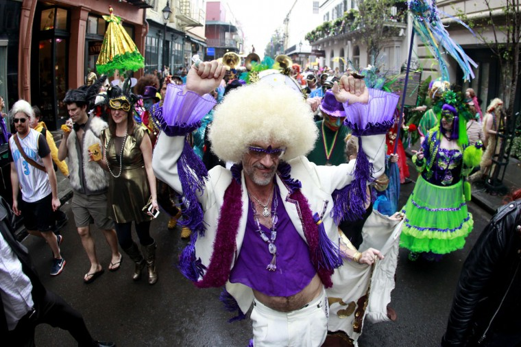 Revelers parade through the French Quarter on Mardi Gras Day in New Orleans, Louisiana February 12, 2013. (Sean Gardner/Reuters)