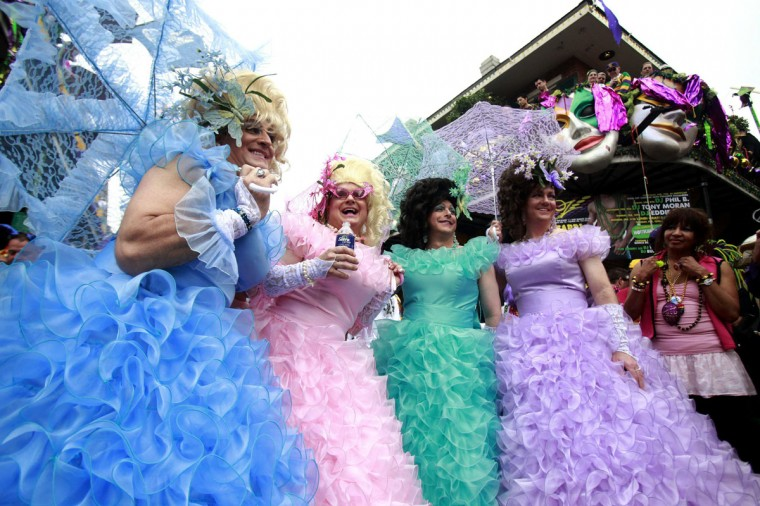 Revelers pose for pictures in the French Quarter on Mardi Gras Day in New Orleans, Louisiana February 12, 2013. (Sean Gardner/Reuters)