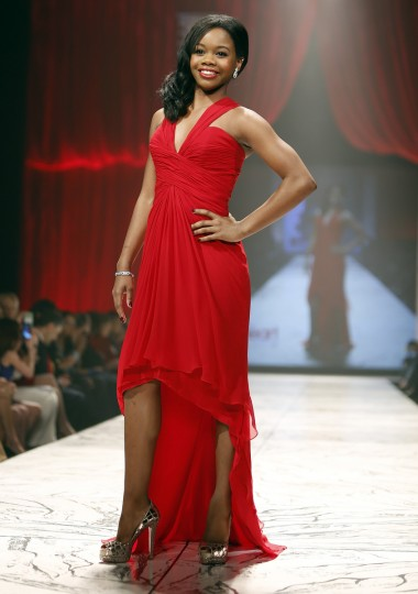 US Olympian Gabby Douglas presents a creation during the The Heart Truth's Red Dress Collection fashion show in New York. (Carlo Allegri/Reuters)