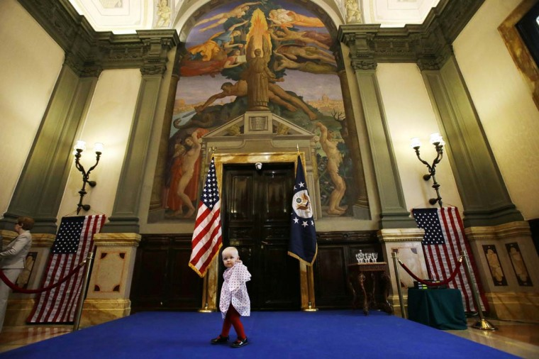 Victoria Tribe, 1, whose father works at the U.S. Embassy in Rome, walks across a set stage as people wait for a visit from U.S. Secretary of State John Kerry, at the embassy in Rome February 28, 2013. (Jacquelyn Martin/Reuters)