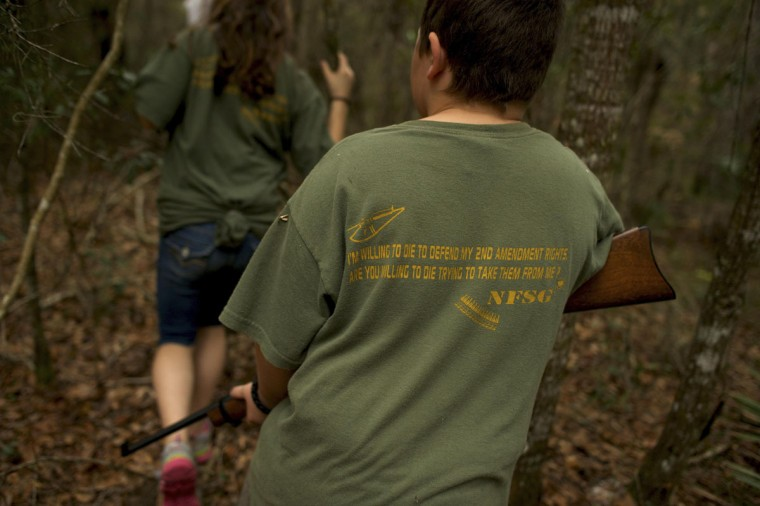 A young boy with the North Florida Survival Group follows his group while performing a land navigation drill during a field training exercise in Old Town, Florida, December 8, 2012. (Brian Blanco/Reuters)