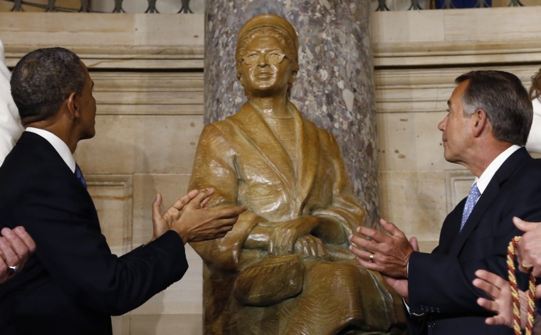 U.S. President Barack Obama (L) and Speaker of the House John Boehner (R) applaud as they look at the statue of Rosa Parks after its unveiling in the U.S. Capitol in Washington. (Kevin Lamarque/Reuters)
