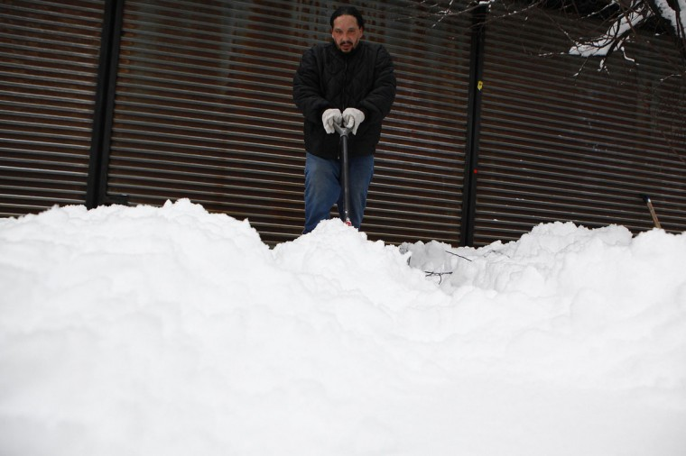 A man shovels snow in the Brooklyn borough of New York, February 9, 2013. A blizzard pummeled the Northeastern United States, killing at least one person, leaving hundreds of thousands without power and disrupting thousands of flights, media and officials said. (Eric Thayer/Reuters)