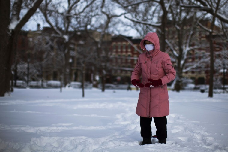 A woman practices meditation after the passing of a winter storm in Jersey City in New Jersey, on February 9, 2013. A blizzard packing hurricane-force winds pummeled the northeastern United States on Friday and Saturday. (Eduardo Munoz / Reuters)