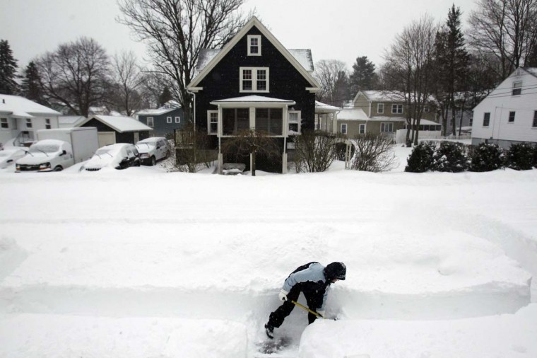 Mary Leahy shovels out her sidewalk during a blizzard in Medford, Massachusetts February 9, 2013. (Jessica Rinaldi /Reuters)