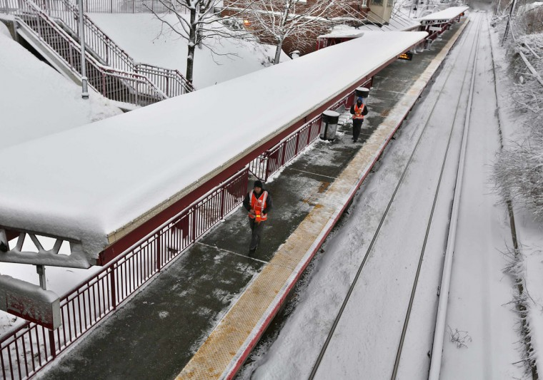 Long Island Railroad workers are seen along the tracks in Manhasset, New York February 9, 2013. (Shannon Stapleton/Reuters)