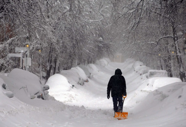 A man drags a shovel up Beacon Hill during a severe winter snow storm in Boston, February 9, 2013. (Brian Snyder/Reuters)