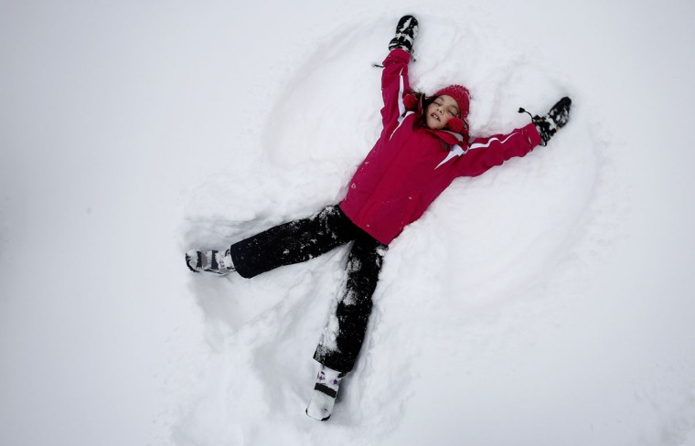 Phoebe Lightburn, 9, makes a snow angel in Central Park in New York February 9, 2013. (Carlo Allegri/Reuters)