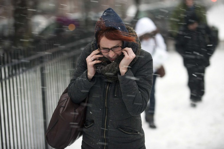 A woman makes her way through snow and wind in New York, February 8, 2013. A blizzard blew into the northeastern United States on Friday, cutting short the workweek for millions who feared being stranded as state officials ordered roads closed ahead of what forecasters said could be record-setting snowfall.(Keith Bedford/Reuters Photo)