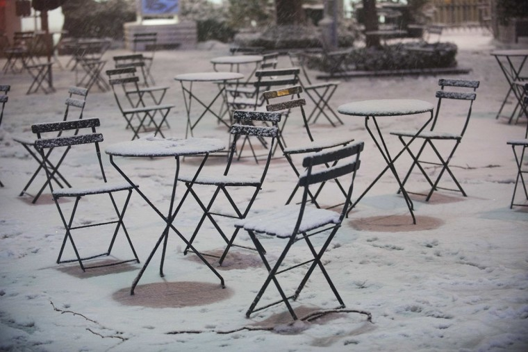 Snow covers cafe tables and chairs in New York's Bryant Park, February 8, 2013. A blizzard pummeled the Northeastern United States, killing at least one person, leaving hundreds of thousands without power and disrupting thousands of flights, media and officials said. (Keith Bedford/Reuters)