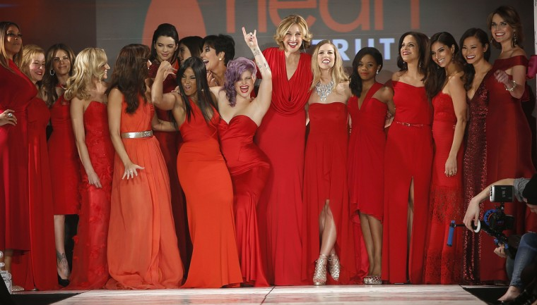 Celebrities present creations at end of The Heart Truth's Red Dress Collection fashion show in New York. (Carlo Allegri/Reuters)