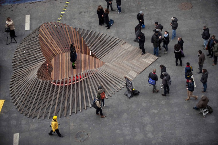 "People walk through ""Heartwalk"", a Times Square Valentine Heart in New York, February 12, 2013. The heart was made from boards salvaged from boardwalks from New York and New Jersey that were damaged by Hurricane Sandy. (Keith Bedford/Reuters)"