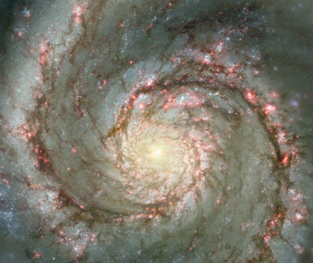The Whirlpool Galaxy, a classic spiral galaxy, is pictured in this NASA handout photo. At only 30 million light years distant and fully 60 thousand light years across, M51, also known as NGC 5194, is one of the brightest and most picturesque galaxies on the sky. This image is a digital combination of a ground-based image from the 0.9-meter telescope at Kitt Peak National Observatory and a space-based image from the Hubble Space Telescope highlighting sharp features normally too red to be seen. (NASA)