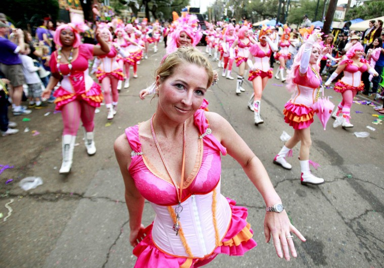 Members of the Pussyfooters Marching Club parade along with the Krewe of Toath along St. Charles Avenue during the weekend before Mardi Gras in New Orleans, Louisiana February 10, 2013. (Sean Gardner/Reuters)