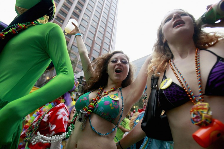 Members of the Mondo Kayo Social and Marching Club parade down St. Charles Avenue on Mardi Gras Day in New Orleans, Louisiana February 12, 2013. (Sean Gardner/Reuters)