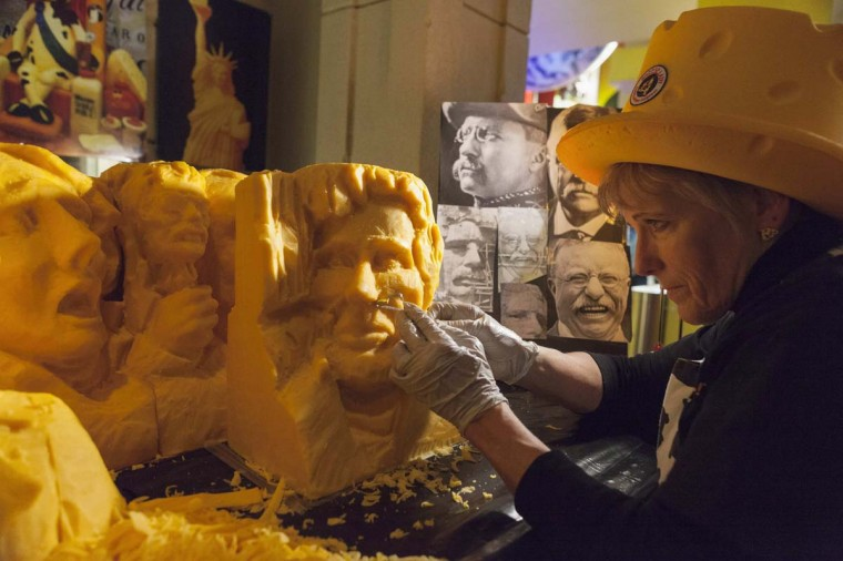 Artist Sarah Kaufmann sculpts an image of Abraham Lincoln ahead of President's Day at Ripley's Believe It or Not! museum in Times Square, New York February 15, 2013. Kaufmann used 160 pounds of cheddar cheese over the span of two days to carve out a replica of the historic Mount Rushmore national monument to commemorate President's Day holiday which is observed on February 18, 2013. Picture taken February 15, 2013. (Zoran Milich/Reuters)