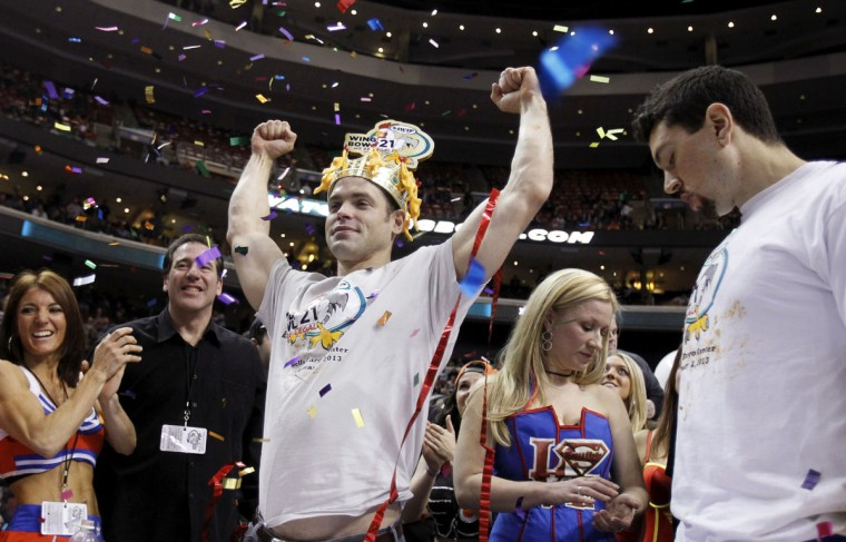 Jamie 'The Bear' McDonald from Granby, Connecticut celebrates winning 'Wing Bowl 21' after eating 287 chicken wings in Philadelphia, Pennsylvania. McDonald upset three-time winner Jon Squibb (R) who consumed 282 for second place. (Tim Shaffer/Reuters)