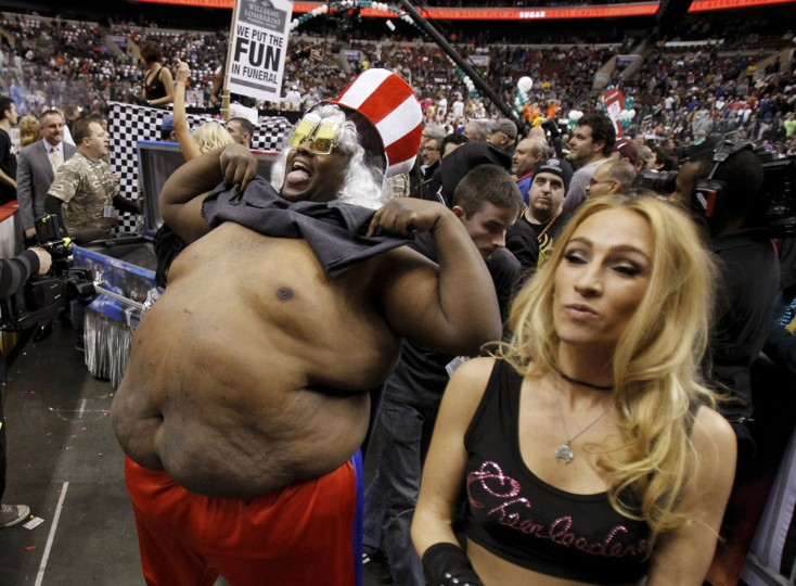 Philadelphia dancer 'Big Daddy' shows his stomach as he parades during the 'Wingbowl 21' in Philadelphia, Pennsylvania. (Tim Shaffer/Reuters)