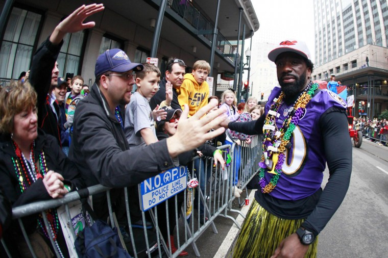 Super Bowl Champion Baltimore Ravens Ed Reed walks with Members of the Zulu Social Aid and Pleasure Club as they parade down St. Charles Avenue on Mardi Gras Day in New Orleans, Louisiana February 12, 2013. (Sean Gardner/Reuters)