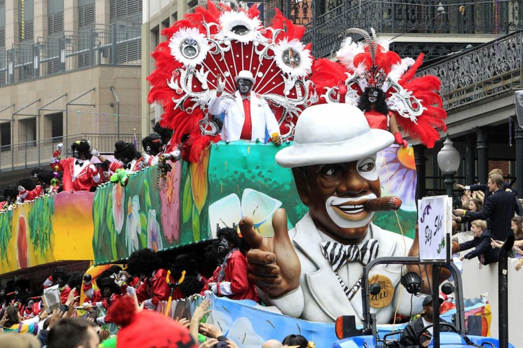 Members of the Zulu Social Aid and Pleasure Club parade down St. Charles Avenue on Mardi Gras Day in New Orleans, Louisiana February 12, 2013. (Sean Gardner/Reuters)