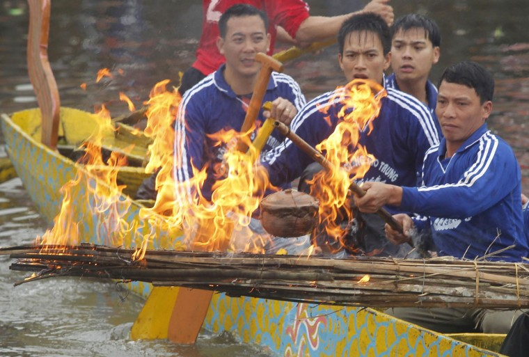 Villagers compete to cook rice in pots on boats as part of the Bach Hao pagoda festival in Thanh Xa village, in Vietnam's northern Hai Duong province, about 80 km (50 miles) east of Hanoi. Villagers also reenacted other daily life activities of the period during the annual festival which takes place on the sixth day of the first month of the lunar calendar. (Kham/Reuters)