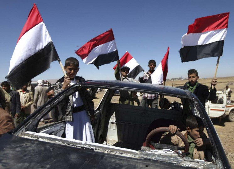 Supporters of the Islah Party carry the Yemen national flag a day before celebrations to mark the second anniversary against the rule of Yemen's former president Ali Abdullah Saleh in the village Hamedan, outside the Yemeni capital Sanaa, February 10, 2013. (Mohamed al-Sayaghi?Reuters)
