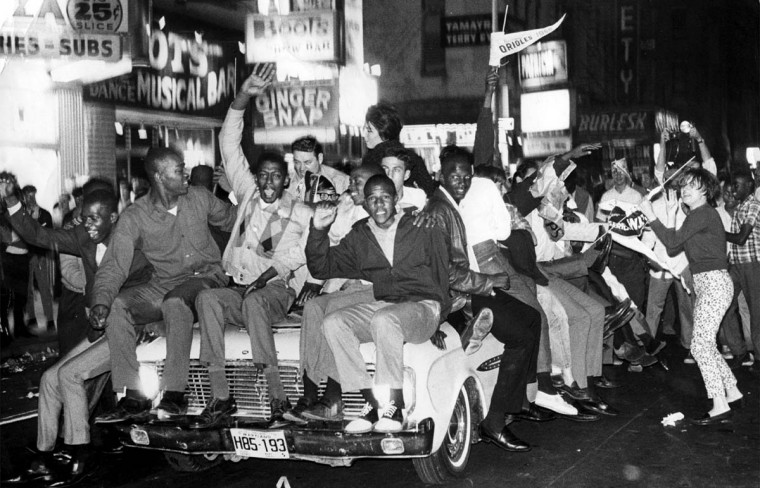 Oct. 9, 1966 — Jubilant Oriole fans on Baltimore Street celebrate after the Orioles won their 4th straight game to win the 1966 World Series. (William L. LaForce, Jr./Baltimore Sun)