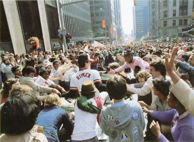 1983: Baltimore Orioles Cal Ripken's car is surrounded by fans during the World Series victory parade through Baltimore. (Lloyd Pearson/Baltimore Sun)