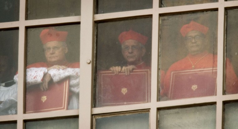 Cardinals look out a window in the Vatican April 19, 2005 in Vatican City. (Peter Macdiarmid/Getty Images)