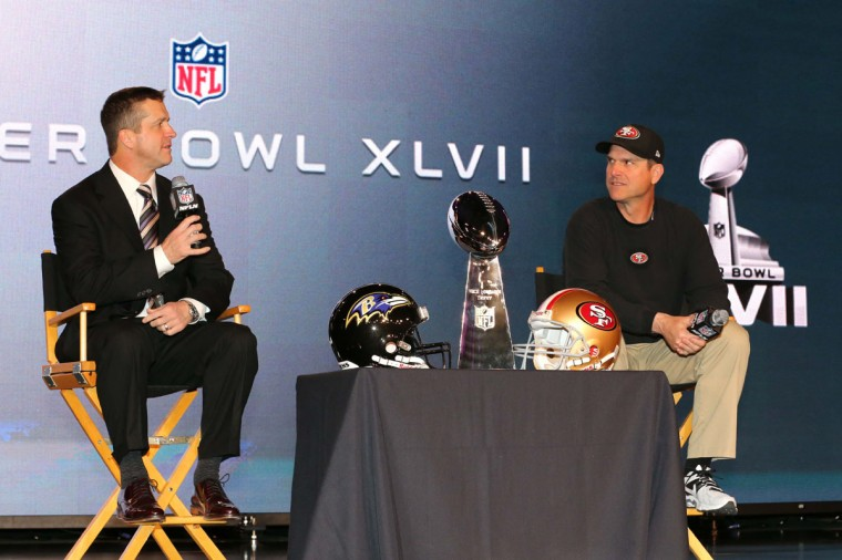 Baltimore Ravens head coach John Harbaugh (left) and San Francisco 49ers head coach Jim Harbaugh speak during a press conference at the New Orleans Convention Center. Super Bowl XLVII will be played between the San Francisco 49ers at the Mercedes-Benz Superdome. (Matthew Emmons/USA TODAY Sports)