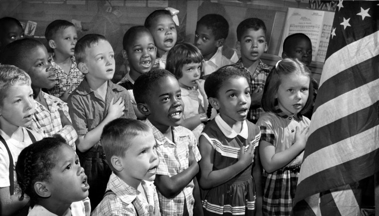 June 26, 55 -BALTIMORE, MD. 1st grade at Public School 60, say the pledge of allegiance to the flag. Richard Stacks/Baltimore Sun