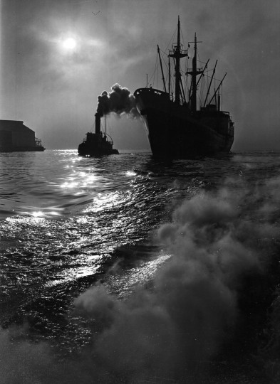 January 22, 1956-A tug meets its escort, a freighter as she enters Baltimore Harbor. Richard Stacks/Baltimore Sun