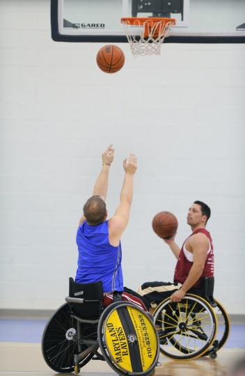Zach Davenport, left, along with Mike Shaffer shoot their free throws during Maryland Ravens wheelchair basketball team practice. (Gene Sweeney Jr./Baltimore Sun)