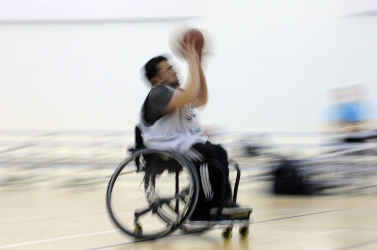 Theodore Luster, Jr. rolls down the court during practice for the Maryland Ravens, the number 1 ranked Division III wheelchair basketball team in the country. (Gene Sweeney Jr./Baltimore Sun)