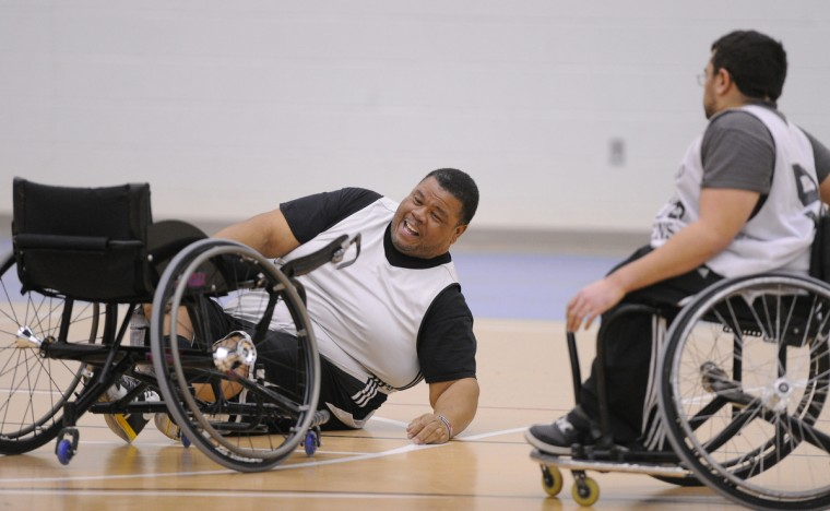 Larry Toler laughs as he picks himself up after falling from his chair during practice. Because of the game's intesity, this is a common occurance for these athletes. (Gene Sweeney Jr./Baltimore Sun)