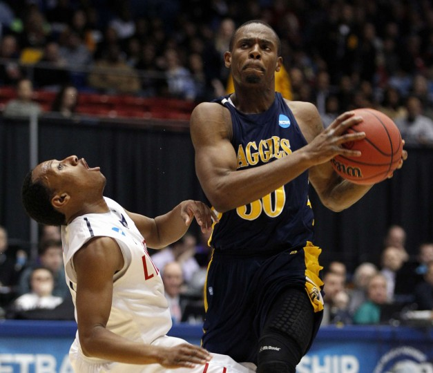 Liberty guard Davon Marshall is fouled by North Carolina A&T defender Lamont Middleton during the first half of their first round NCAA tournament basketball game in Dayton, Ohio. (Matt Sullivan/Reuters)